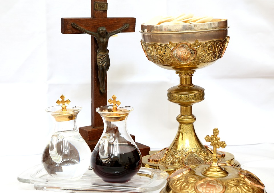 cross with water, wine and hosts